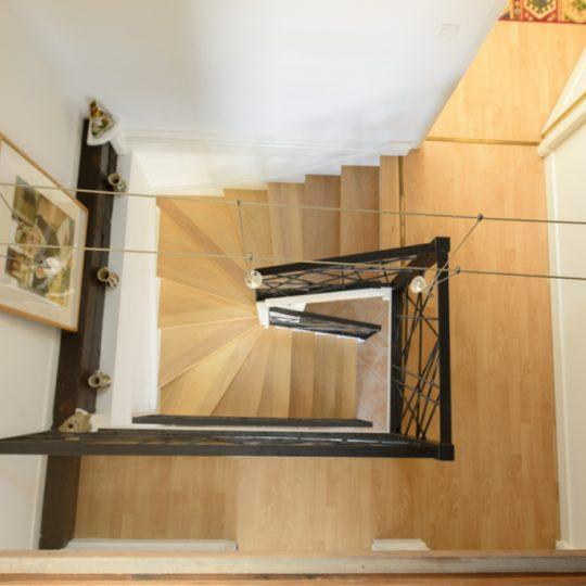 escalier double quart tournant avec garde corps en metal